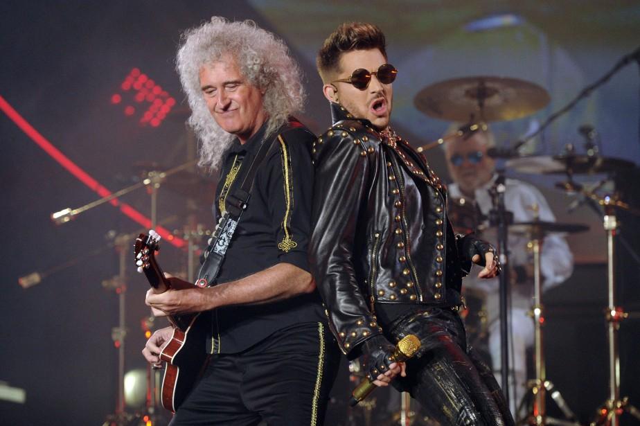 Le guitariste du groupe Queen, Brian May, et... (Photo Chris Pizzello, archives AP)