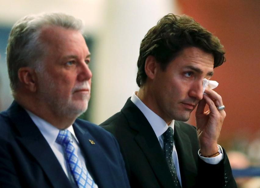 Le premier ministre du Québec,Philippe Couillard, et celui du Canada, Justin Trudeau, pendant la cérémonie. | 3 février 2017