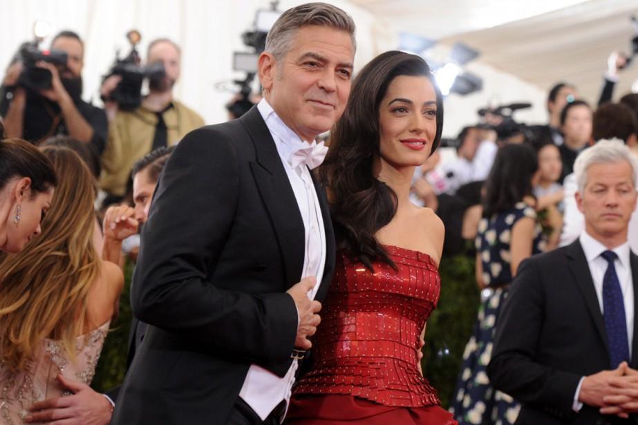 George Clooney et sa femme Amal.... (PHOTO ARCHIVES AP)