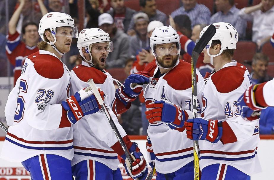 Andrei Markov (troisième à gauche) était de retour et a fait sentir sa présence avec un but en première période. (Photo Ross D. Franklin, AP)
