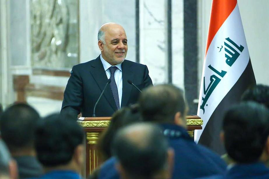 Haider Al-Abadi a exhorté Donald Trump «de retirer... (PHOTO ARCHIVES AFP/FOURNIE PAR LE BUREAU DU PREMIER MINISTRE IRAKIEN)