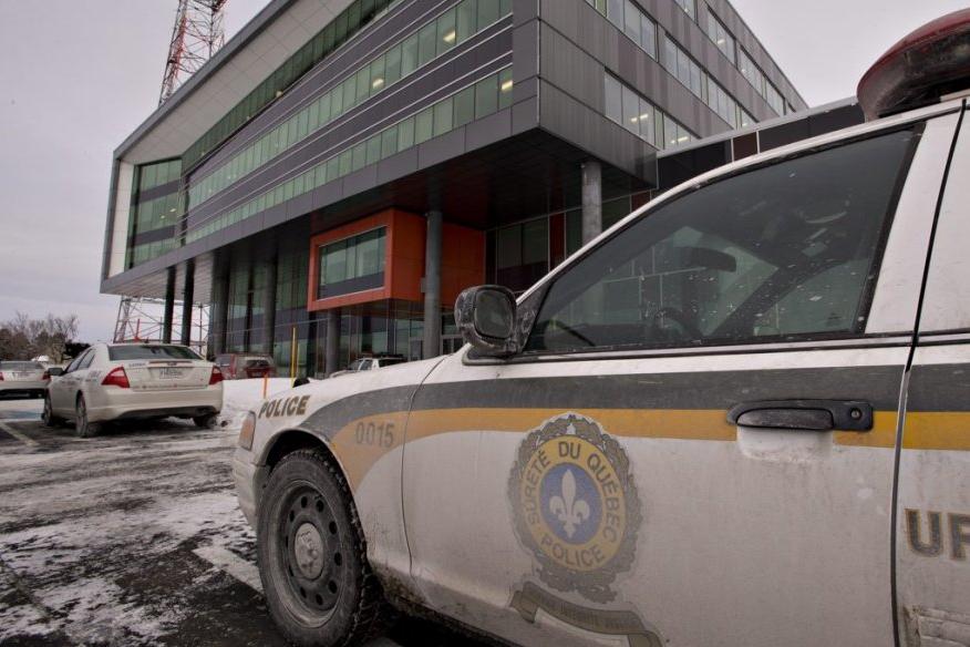 Perquisition de la SQ au siège social de... (Archives La Presse Canadienne)