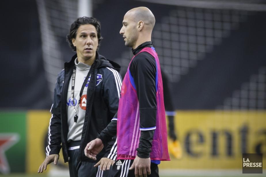 L'entraîneur-chef de l'Impact, Mauro Biello, et le défenseur... (Photo Olivier Jean, archives La Presse)