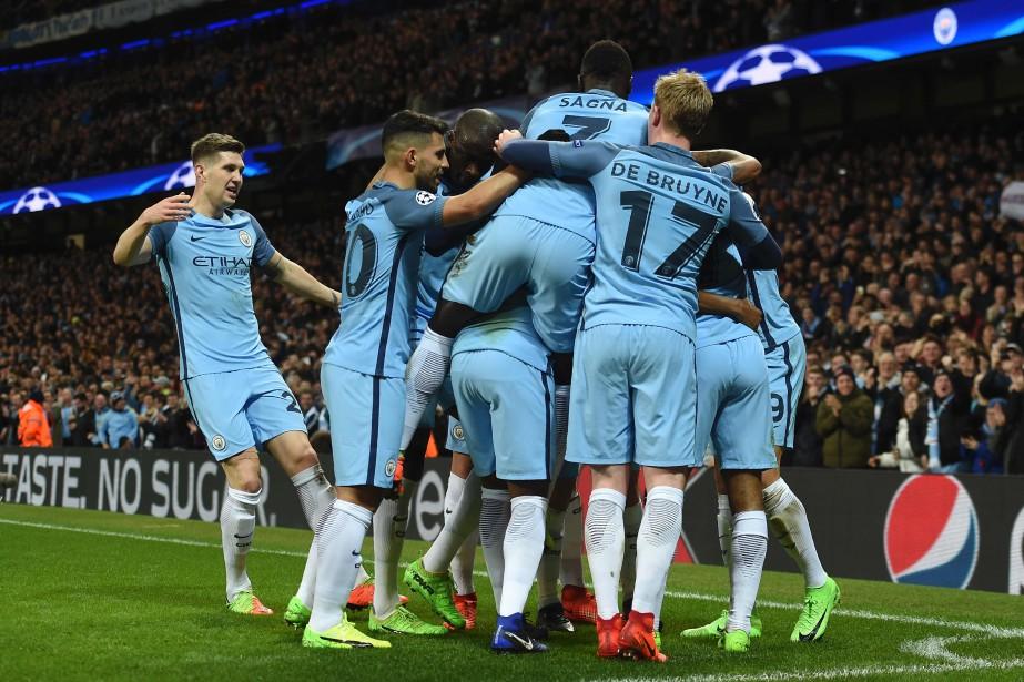 Manchester City a marqué trois buts en 11... (Photo PAUL ELLIS, AFP)