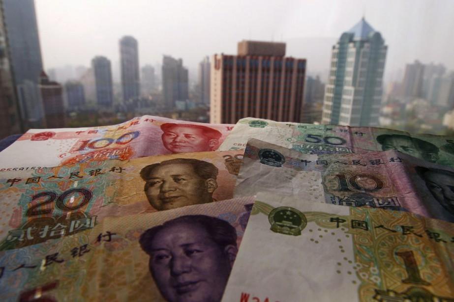 La devise chinoise évolue actuellement autour de 7... (PHOTO ARCHIVES REUTERS)