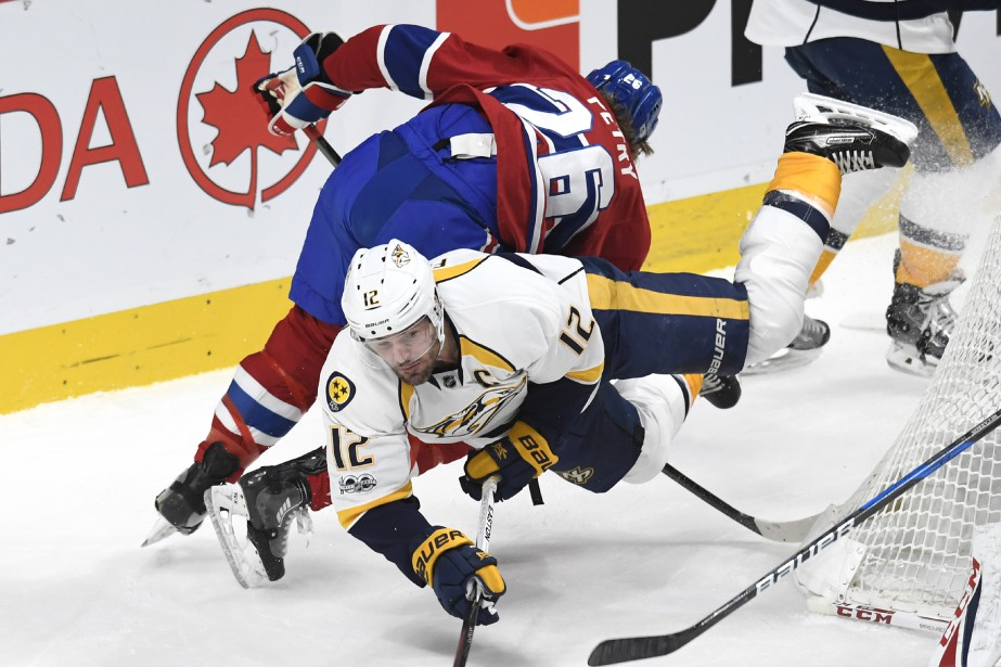 Jeff Petry met solidement en échec Mike Fisher. (PHOTO BERNARD BRAULT, LA PRESSE)