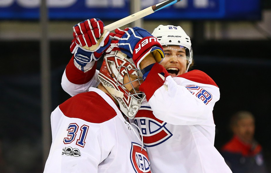 Nathan Beaulieu célèbre la victoire du Canadien avec son gardien Carey Price. (Photo Andy Marlin, USA TODAY Sports)