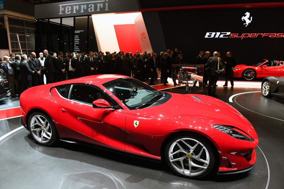 People stand next to the new Ferrari 812...