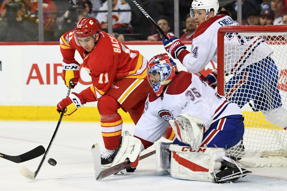 Mikael Backlund et Al Montoya... (Photo Candice Ward, USA TODAY Sports)