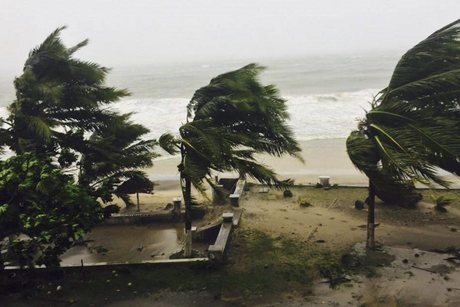 Le cyclone a frappé mardi à la mi-journée... (photo Manny Horsford, AP)