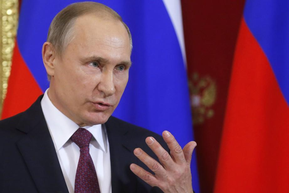Plus tôt cette année les présidents Vladimir Poutine... (Photo Sergei Ilnitsky, REUTERS)