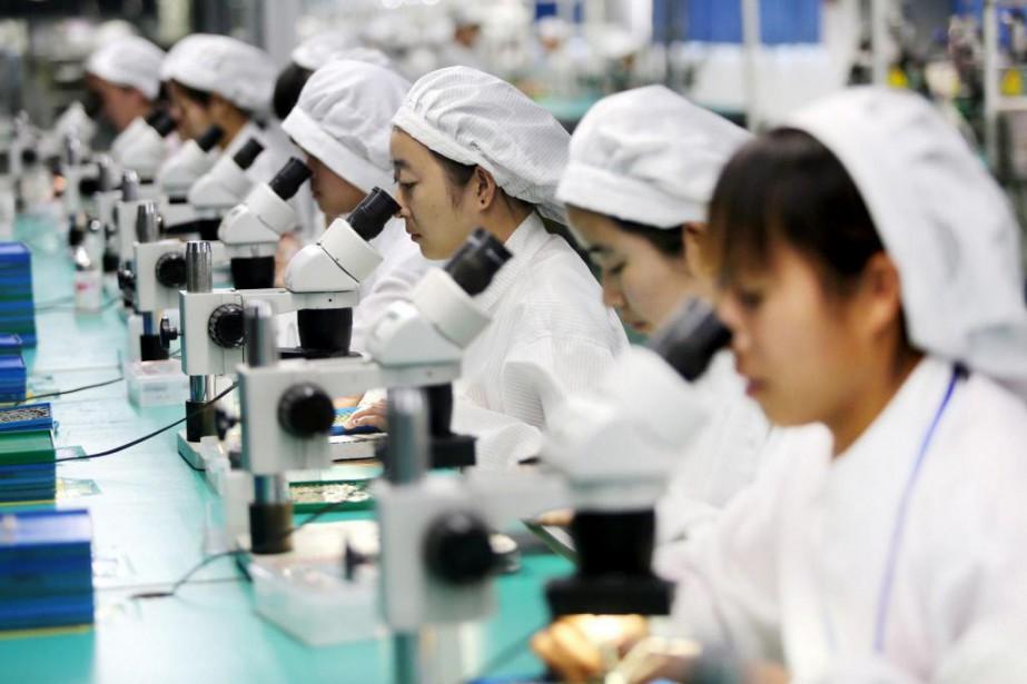 Les travailleurs d'usines chinoises ont été payés l'an... (PHOTO ARCHIVES AGENCE FRANCE-PRESSE)