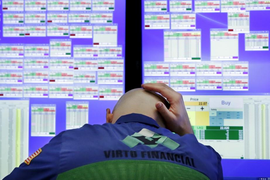 Wall Street a légèrement baissé, pénalisée par le... (Photo Richard Drew, AP)