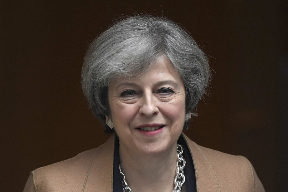 Theresa May... (Photo Toby Melville, archives REUTERS)