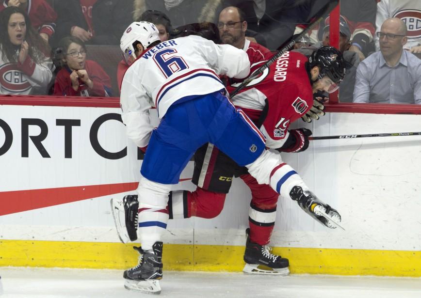 Un match physique samedi soir entre le Canadien et les Sénateurs: Shea Weber et Derick Brassard en ont fait la démonstration en deuxième période. (Photo Adrian Wyld, La Presse canadienne)