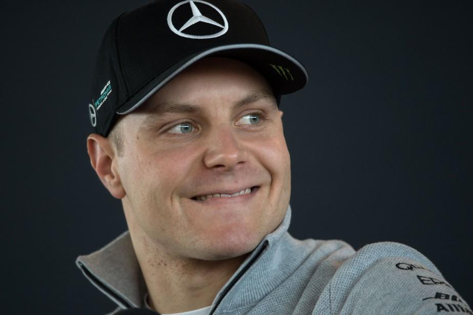 Valtteri Bottas est devenu pilote en titre chez Williams en 2013, grâce à l'apport de ses deux commanditaires finlandais. Mais il a amplement prouvé depuis qu'il méritait sa place en F1, ce qui lui a valu sa promotion chez Mercedes. On le voit ici au circuit anglais de Silverstone lors du dévoilement des voitures F1 Mercedes 2017 le 23 février. (AFP)