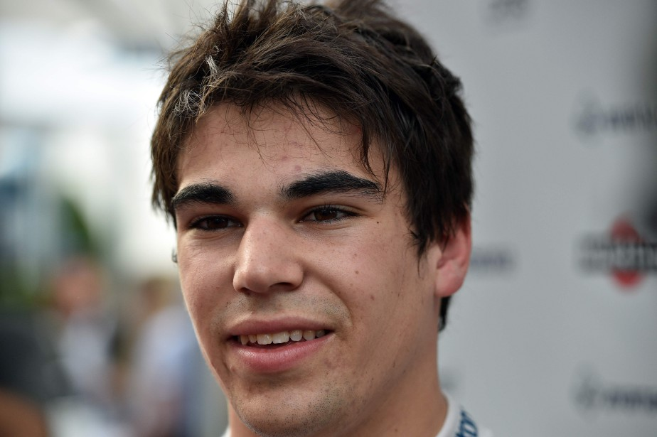 Williams' Canadian driver Lance Stroll speaks to the...