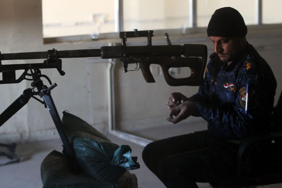 L'EI «a commencé à utiliser des citoyens comme... (Photo Ahmad Al-Rubaye, Agence France-Presse)