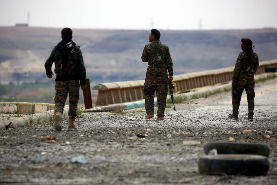 «Les batailles font rage sur tous les fronts... (AFP)