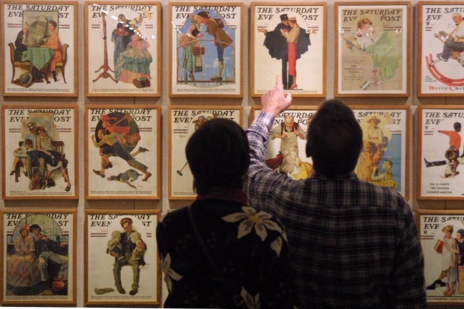 Des visiteurs du musée Norman Rockwell regardent les... (Photo archives Associated Press)