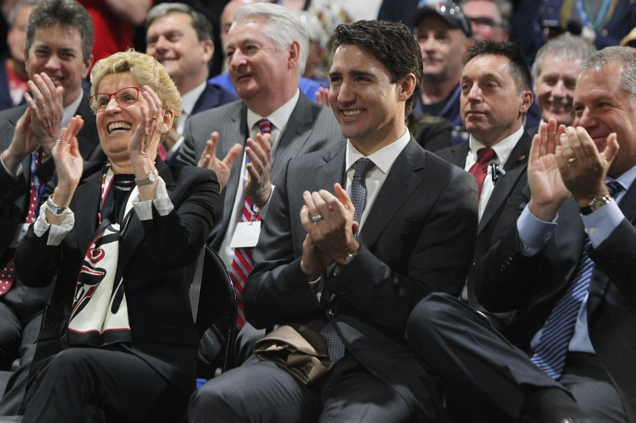 Prime Minister Justin Trudeau, centre, Ontario Premier Kathleen...