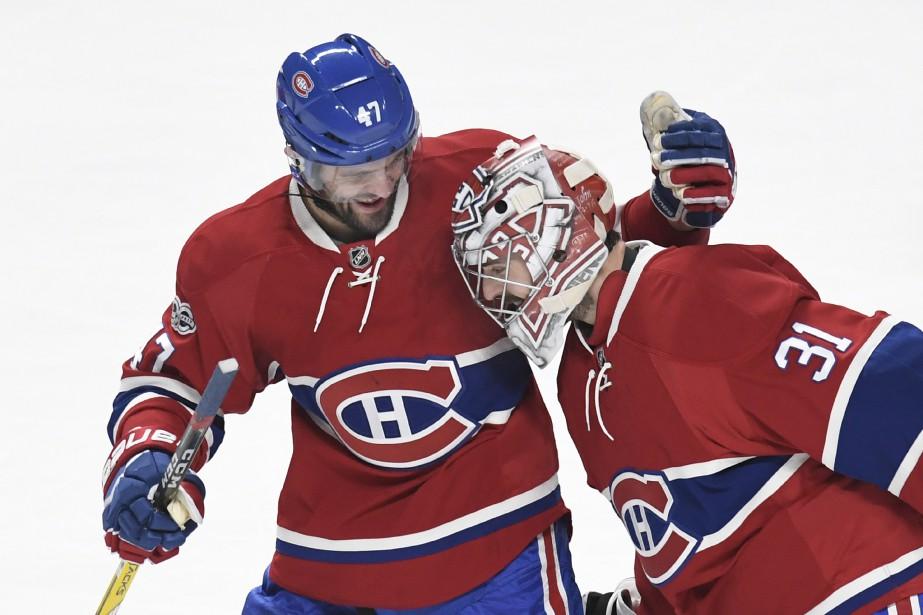 Carey Price célèbre la victoire du Canadien avec Alexander Radulov. (Photo Bernard Brault, La Presse)