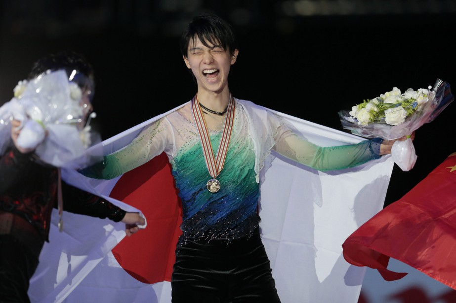 Hanyu Yuzuru est champion du monde: il a inscrit... (Photo Ivan Sekretarev, AP)