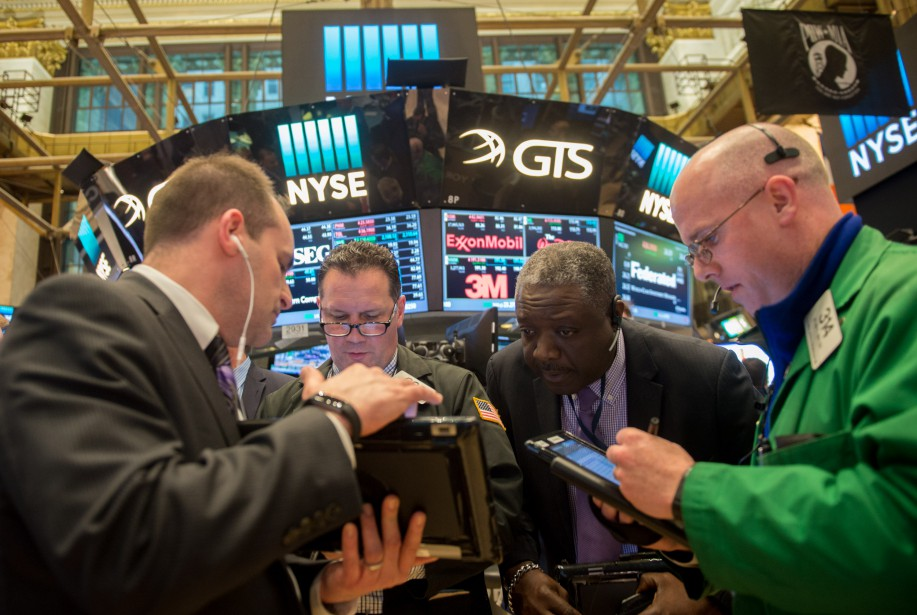 Wall Street a légèrement baissé lundi, l'attentisme... (Photo archives AFP)