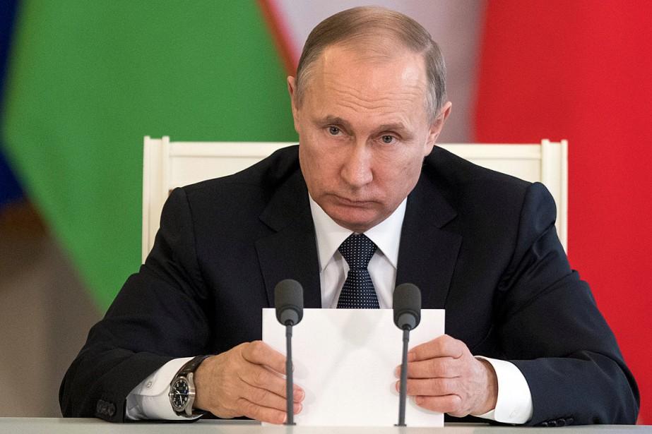Le président russe Vladimir Poutine... (Photo Pavel Golovkin, REUTERS)
