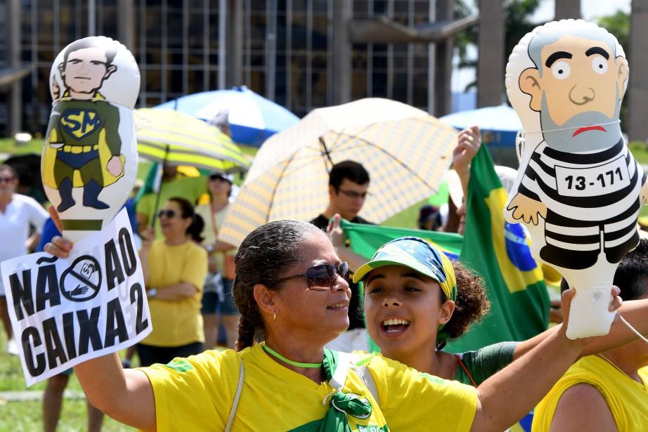 Plusieurs manifestations contre la corruption ont animé les... (PHOTO AFP)