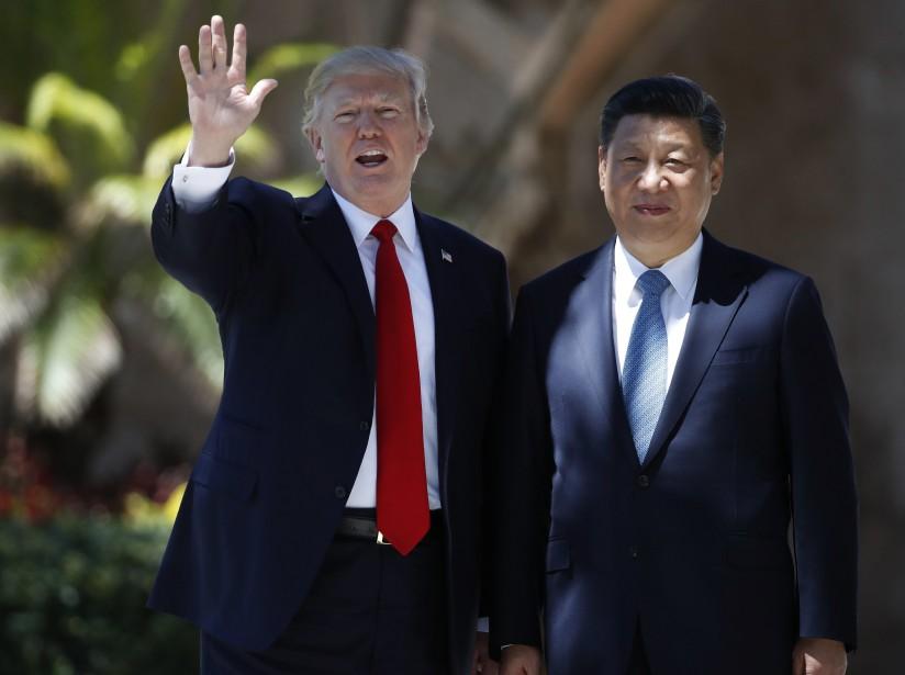 Donald Trump et Xi Jinping posent pour les... (PHOTO AP)