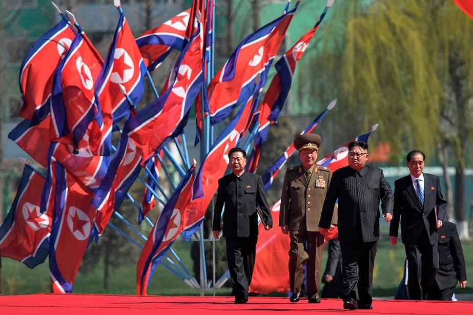 Des dizaines de milliers de soldats, de responsables... (Ed JONES, AFP)