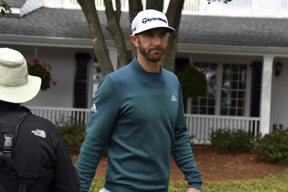 Dustin Johnson a dû se retirer du Tournoi... (Photo Brant Sanderlin, AP)