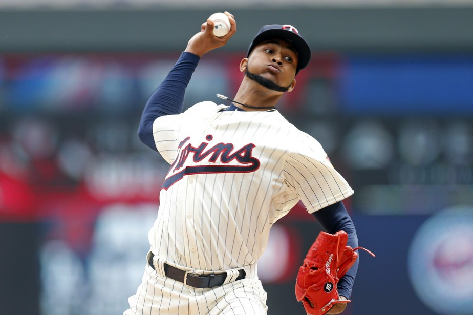 Le lanceur Ervin Santana... (Photo Jim Mone, AP)