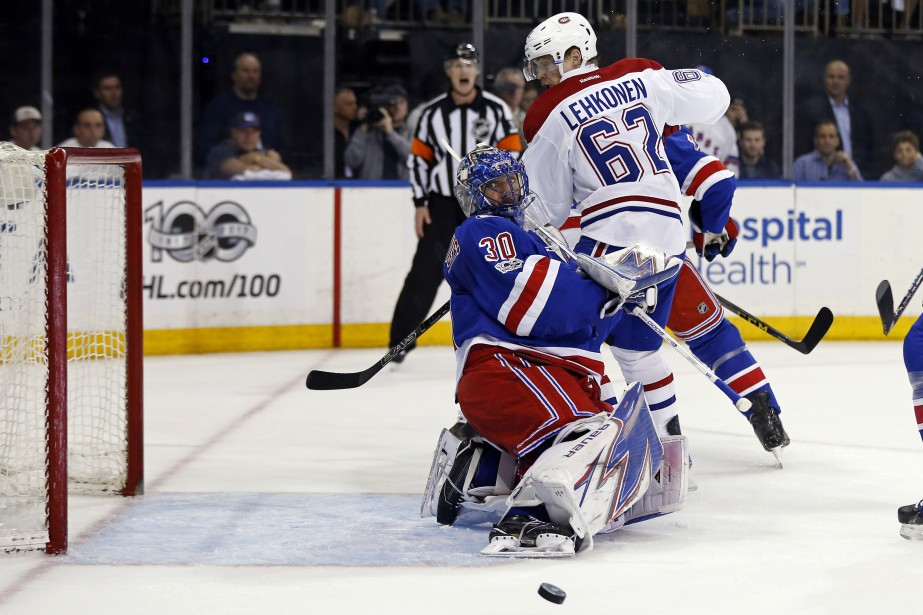 Henrik Lundqvist arrête le tir de Max Pacioretty et, en même temps, Artturi Lehkonen. (Photo Adam Hunger, USA TODAY Sports)