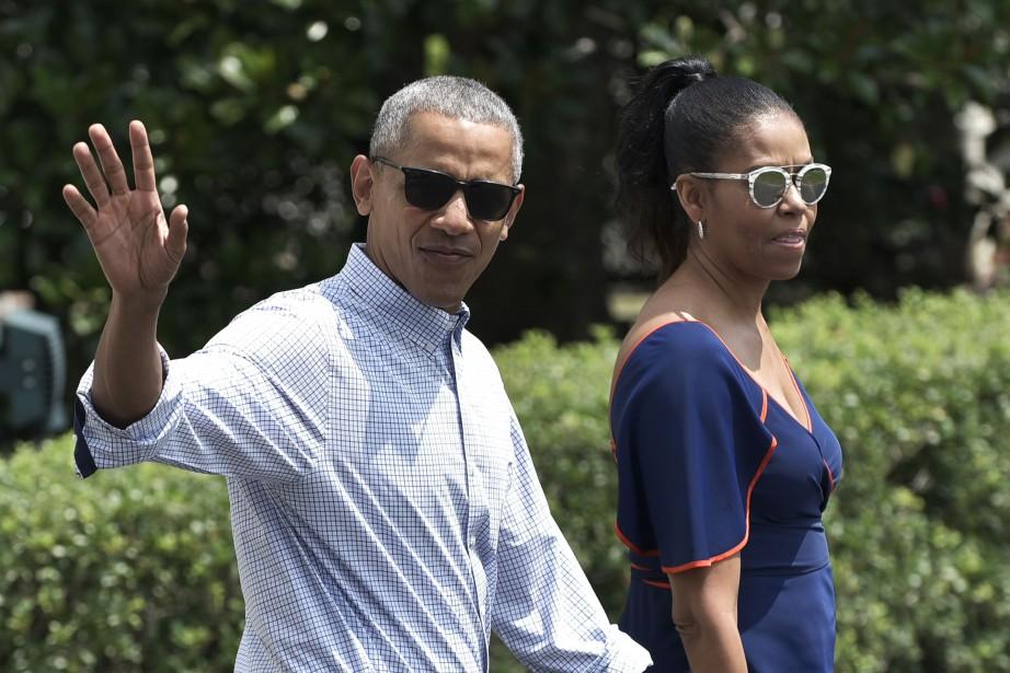 Barack Obama et sa femme Michelle, en août... (Photo archives AFP)
