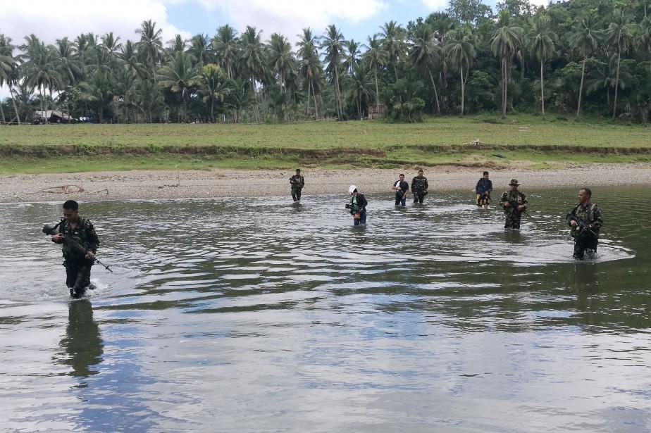 En plus des quatre homme tués samedi, six... (AFP)