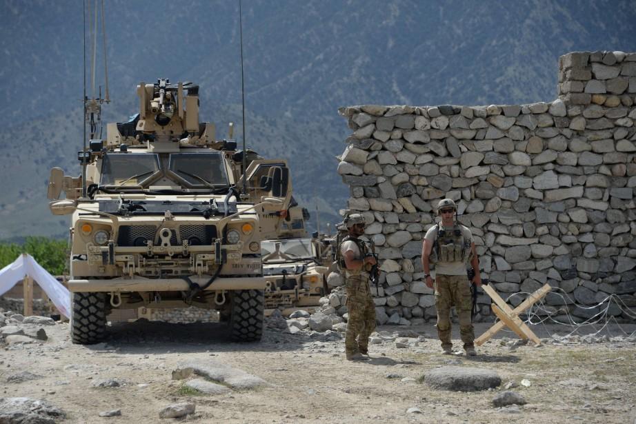 Des soldats américains patrouillent le district d'Achin, où... (PHOTO AFP)