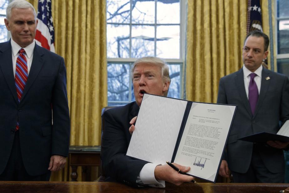 Dans le brouillon du décret américain, on y... (Photo Evan Vucci, AP)