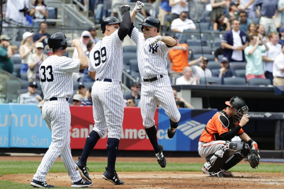 Aaron Judge (99) et Greg Bird (33) attendent... (Photo Frank Franklin II, Ap)