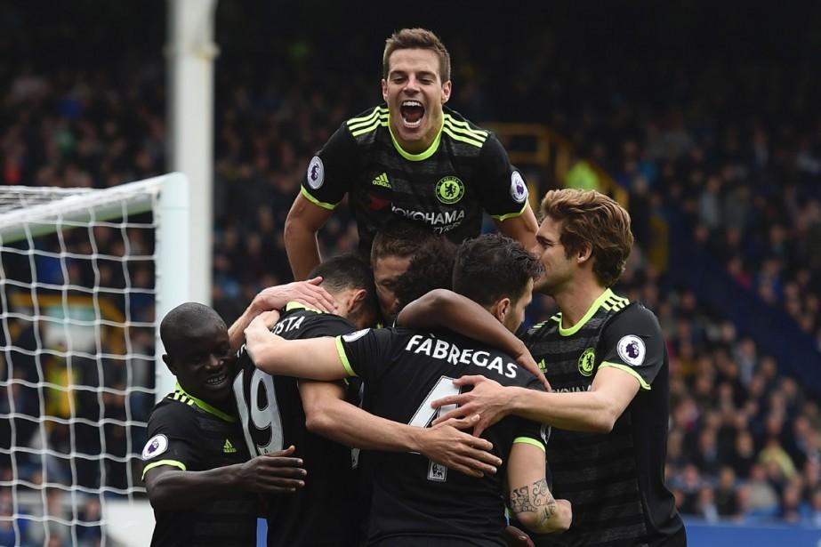 Avec quatre matchs encore à disputer, Chelsea dispose... (PHOTO PAUL ELLIS, AGENCE FRANCE PRESSE)