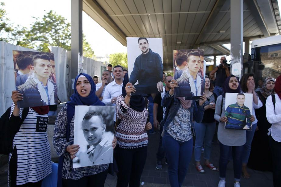 Les familles de Palestiniens détenus dans des prisons... (PHOTO AHMAD GHARABLI, AGENCE FRANCE-PRESSE)