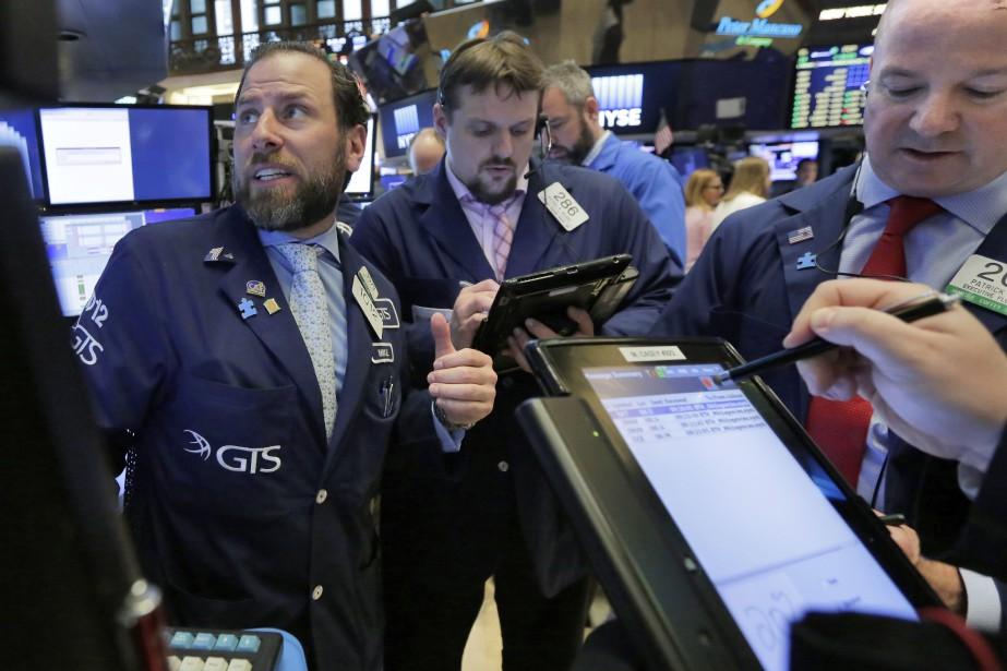 Wall Street a terminé en très légère hausse mardi,... (Photo Richard Drew, AP)