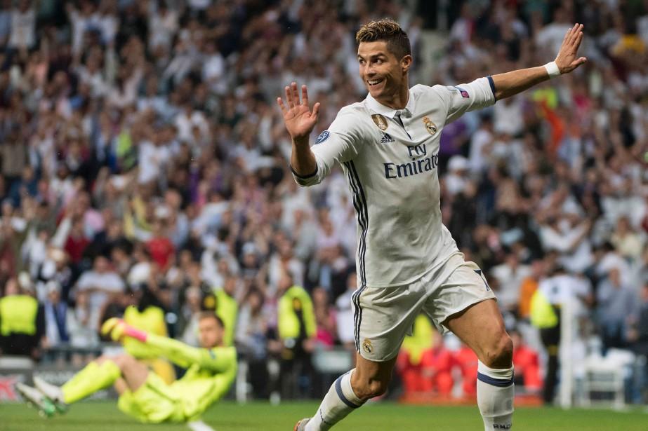 Cristiano Ronaldo a marqué les trois buts du... (Photo CURTO DE LA TORRE, AFP)