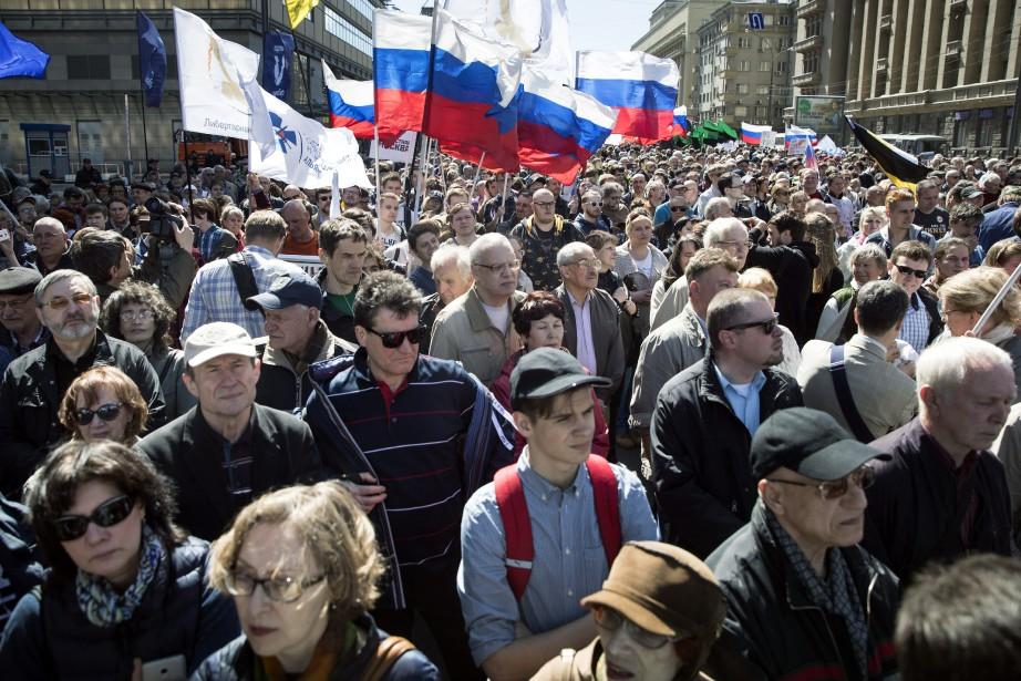 Les manifestations ont été organisées en mémoire des... (Photo Pavel Golovkin, AP)