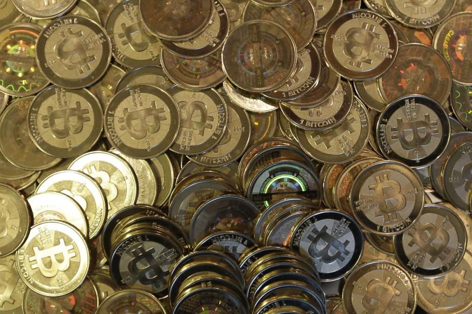 Le bitcoin, qui tire son origine d'un logiciel... (THE ASSOCIATED PRESS)
