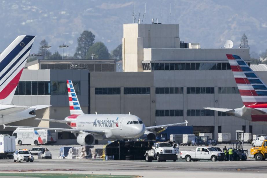 Tous les 146 passagers et membres d'équipage de... (Photo Damian Dovarganes, AP)