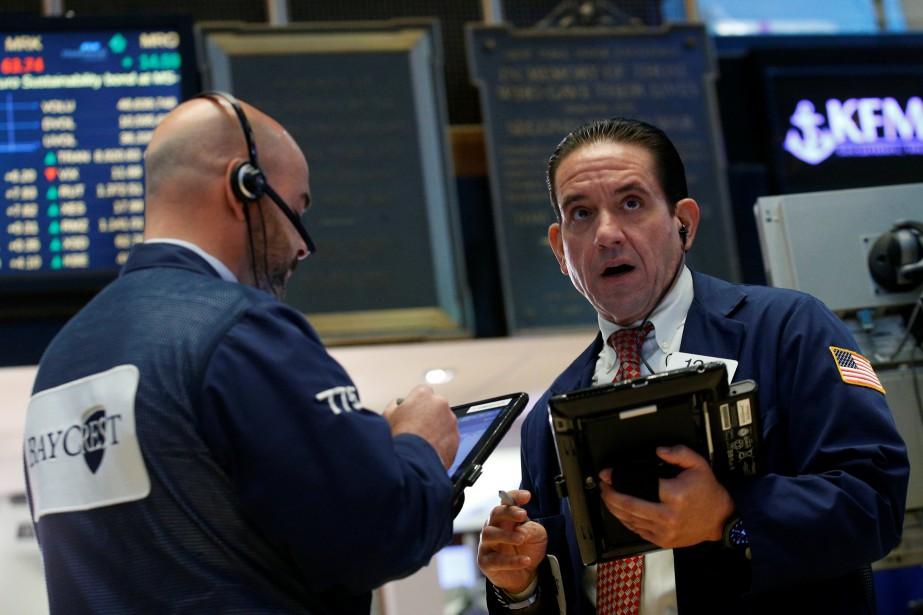 Les Bourses nord-américaines ont légèrement monté mardi, à... (Photo REUTERS)