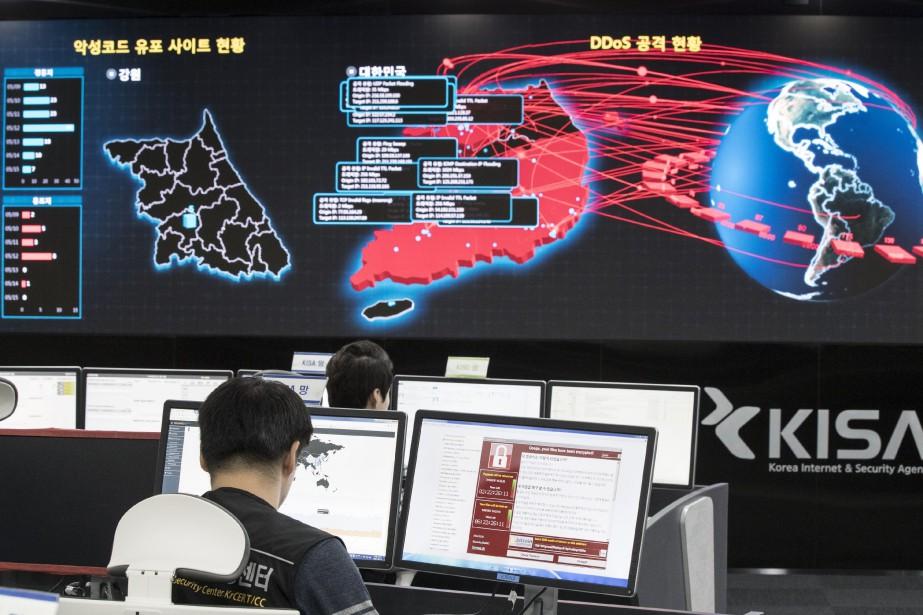 Des spécialistes de la sécurité informatique en Corée... (AP)