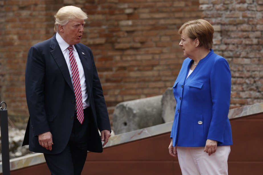 Donald Trump et Angela Merkel.... (AP)